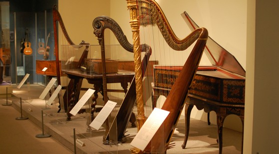 Admiring the antique harps at the MET in New York City.